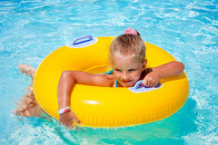 Child  on inflatable ring in swimming pool Stock Photography