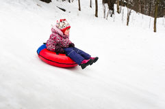 Child on inflatable sleds Stock Photo