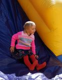 Child on inflatable slide. In bouncy castle outdoor Stock Photo