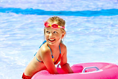 Child  on inflatable in swimming pool. Stock Photos