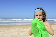 Child inflating inflatable swim ring on the beach Stock Photos