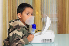 Child with inhalation mask. Medical equipment, Child with inhalation mask on face Royalty Free Stock Image