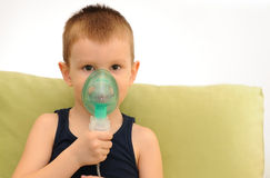 Child with inhalation mask on face stock photography