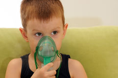 Child with inhalation mask on face stock photos
