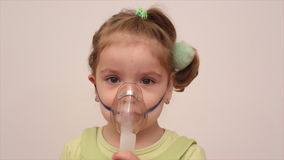 Child with inhalation mask stock video