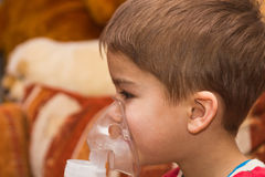 Child and inhaler Stock Images