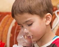 Child and inhaler Royalty Free Stock Photos