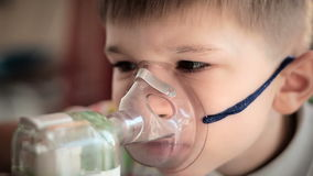 Child with inhaler 4 stock video footage