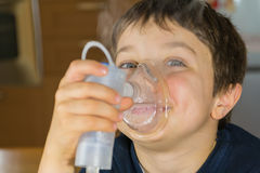 Child with inhaler mask. Child taking respiratory, inhalation therapy Stock Photos