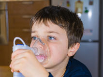 Child with inhaler mask Stock Images