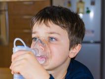 Child with inhaler mask Stock Images