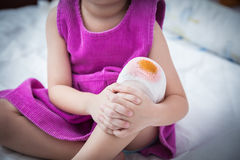 Child injured. Wound on the child's knee with bandage. Royalty Free Stock Photos