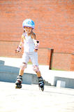 Child on inline rollerblade skates Stock Photography