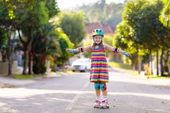 Child on inline skates. Kids skate roller blades stock image
