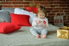 Santa Christmas Baby With Magic Sparkles Stock Image