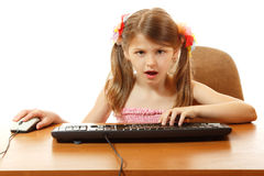 Child with internet dependence with keyboard looking at camera l. Ike in monitor, girl 8 year old, isolated on white Royalty Free Stock Photo