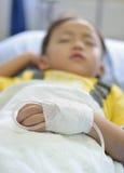 Child intra venous fluid. Intra venous fluid line at left arm of boy patient stock images
