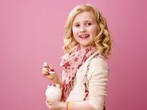 Child isolated on pink background eating farm organic yogurt. Pink mood. happy modern child with wavy blonde hair isolated on pink background eating farm organic Royalty Free Stock Photos