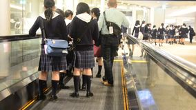 Child japanese student group walking in Airport go to gate for educational tour. TOKYO, JAPAN - OCTOBER 21 : Child japanese student group walking in Airport go stock video