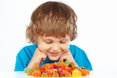 Child with jelly candies on white background Royalty Free Stock Photos