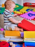 Child jigsaw develops children. Kid puzzle making baby. Stock Photo