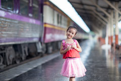 Child Journey by train on platform of railway station in thailan Royalty Free Stock Photos