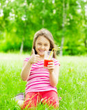 Child and juice Royalty Free Stock Images