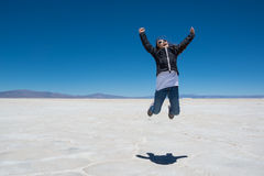 Child jump on Salinas Grandes Stock Images