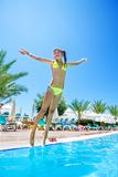 Child jump in  swimming  pool Royalty Free Stock Photos