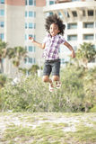 Child jumping Stock Images