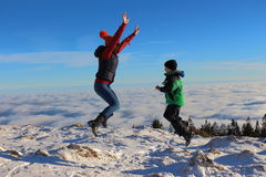 Child jumping. In the air over the clouds Royalty Free Stock Image