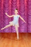 Child jumping ballerina dancer on stage Stock Photo