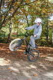 Child jumping with the Bike at Stock Photography