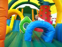 Child jumping in bouncy castle. Child jumping in colour bouncy castle Stock Image