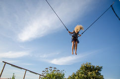 Child jumping in bungee attraction Royalty Free Stock Images