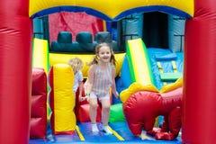 Child jumping on playground trampoline. Kids jump. Royalty Free Stock Photos