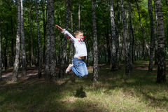 Child jumping in a forest Stock Photos