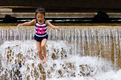 Child Jumping in a Fountain on a Hot Day Royalty Free Stock Images