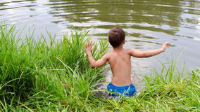 Child jumping into lake or pond Royalty Free Stock Photos