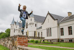 A child is jumping near Alatskivi Castle. Young boy is jumping on the rocks near Alatskivi Castle in Estonia Stock Photography