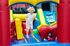 Child jumping on playground trampoline. Kids jump. Royalty Free Stock Photography