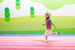 Child jumping on playground trampoline. Kids jump. Royalty Free Stock Image