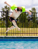 Child jumping into pool Stock Photos