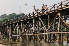 A child jumping from Saphan Mon Mon Bridge to Song Karia river. Kanchanaburi, Thailand - December 09, 2013: A child jumping from Saphan Mon Mon Bridge to Song Stock Images
