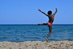 Child jumping and sea Stock Images