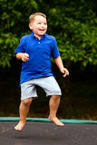 Child jumping on trampoline Stock Photos