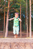 Child jumps down Stock Photography