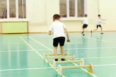 Child jumps in the gym stock photography