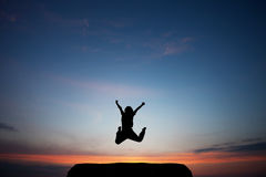 Child jumps in sunset sky Royalty Free Stock Photo