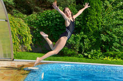 Child jumps to swimmimg pool Royalty Free Stock Photos